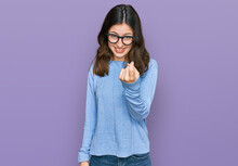 Young Beautiful Woman Wearing Casual Clothes And Glasses Beckoning Come Here Gesture With Hand Inviting Welcoming Happy And Smiling