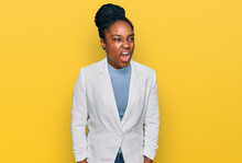 Young African American Woman Wearing Business Clothes Angry And Mad Screaming Frustrated And Furious, Shouting With Anger. Rage And Aggressive Concept.