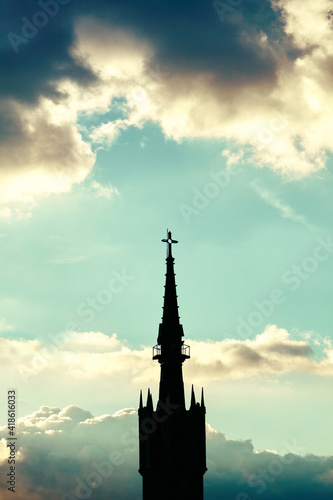 church backlit with sky in the background at sunset
