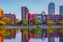 Boston Back Bay Buildings And Reflections Over Storrow Lagoon Of Charles River. Saturated Image.