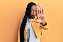 Young African American Woman Wearing Casual Jacket Doing Stop Sing With Palm Of The Hand. Warning Expression With Negative And Serious Gesture On The Face.