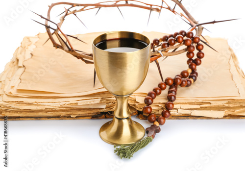 Holy Bible with chalice of wine, beads and crown of thorns on white background Fototapeta