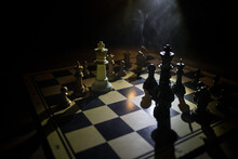Chess Board Game For Ideas And Competition And Strategy, Business Success Concept. Chess Figures On Dark