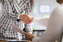Closeup Of Handshake Business Man And Woman In Office. Favorable Conclusion Of Contracts Concept