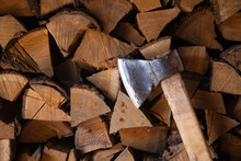 Woodpiles Are Freshly Cut Logs. A Stack Of Tree Trunks. Hit The Chopped Wood. Forestry. Ax.