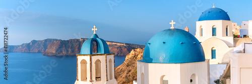 Canvas Print Local church with blue cupola in Oia, Santorini, Greece