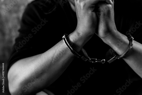 Fotografiet Criminal concept Bad guy was cuffed and under arrest by policeman and detain pri