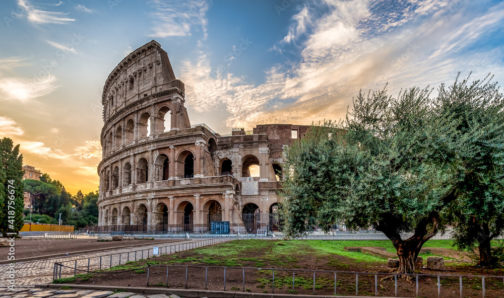 Fototapeta Colosseum in Rome (Roma), Italy. The most famous Italian sightseeing on blue sky