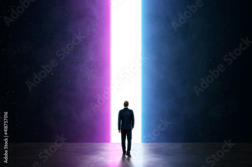 Silhouette of a man in a business suit in front of a glowing neon portal, futuristic background, abstract architecture Fototapeta