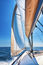Sailing Boat At Open Sea On A Bright Sunny Day, Vertical