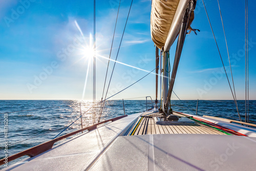 Obraz na płótnie Sailing boat at calm open sea on a bright sunny day