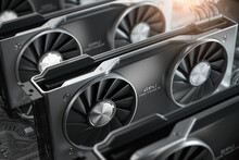 Graphics Cards GPU Standing In A Row In Mining Farm Or 3d Render Farm. IT Hardware.