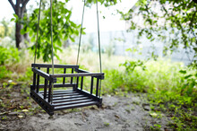 Wooden Swing At Garden. Selective Focus With Shallow Depth Of Field