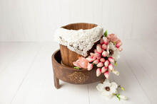 The First Photo Session Of The Newborn. Photo Session Of A Newborn. Baby Basket For A Photo Shoot Of Newborns. Props For A Photo Shoot. The Bed Is Decorated With Tulip Flowers. Furniture For Dolls