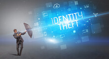 Businessman Defending With Umbrella From Cyber Attack And IDENTITY THEFT Inscription, Online Security Concept