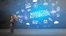Businessman Defending With Umbrella From MARKETING AUTOMATION Inscription, Modern Technology Concept