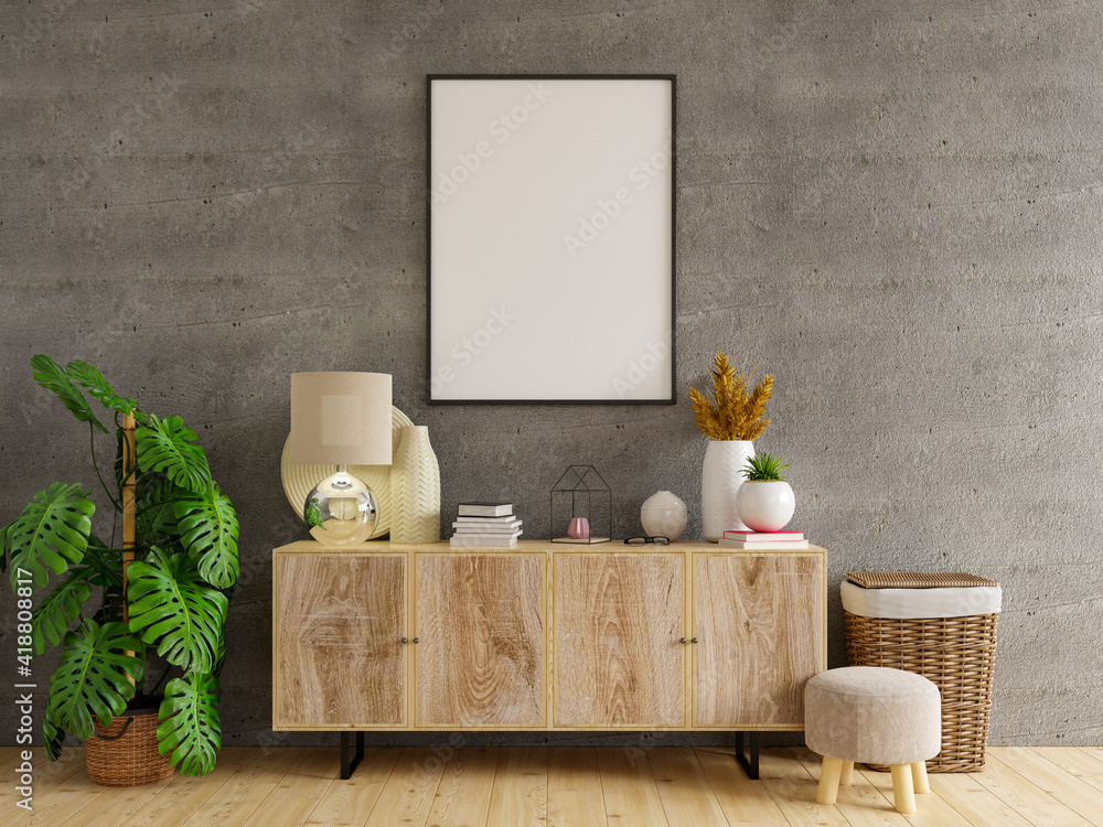 Fototapeta Mockup frame on cabinet in living room interior on empty concrete wall background.