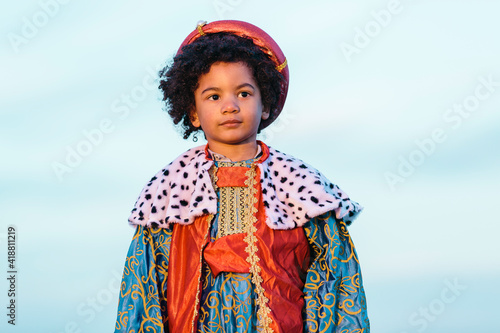 Fotografering Black child with afro hair, dressed in a wise man's costume