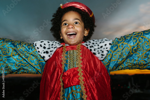 Canvastavla Black child with afro hair, dressed in a wise man's costume