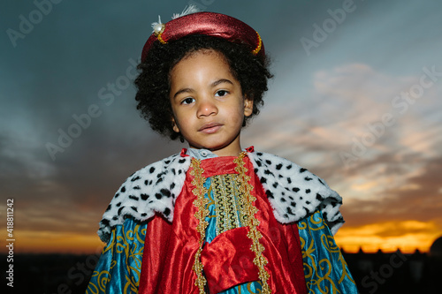 Fotografie, Obraz Black child with afro hair, dressed in a wise man's costume