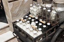 Bottles And Aluminum Cans Of Milk For Delivery In Vintage Milkman Bicycle