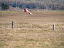 Worn Out Windsock On Abandoned Sport Airport.  The Wind Is Blowing Lazy