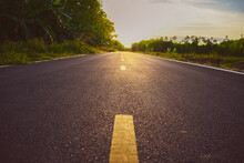 The Yellow Line In The Middle Of The Country Road In The Evening. The Road Is Paved In The Evening. Used For Background