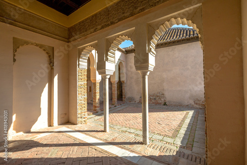 Obraz Malaga, Andalucia, Spain - April 16, 2016: inside with portico and columns in Alcazaba. The place is declared Unesco World Heritage Site. - fototapety do salonu