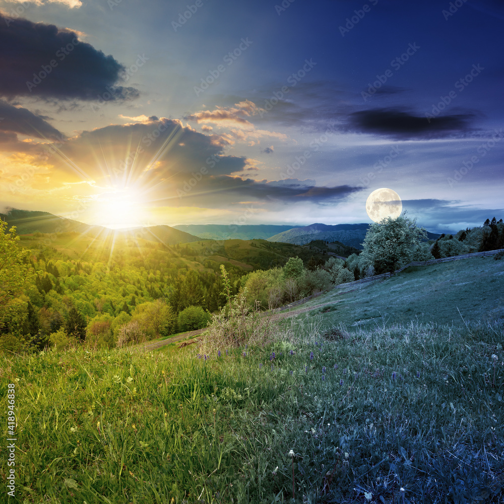 Fototapeta day and night equinox time change concept above mountainous countryside scenery in spring. trees and grass on hills rolling through green valley in to the distant ridge with sun and moon on the sky
