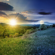 Day And Night Equinox Time Change Concept Above Mountainous Countryside Scenery In Spring. Trees And Grass On Hills Rolling Through Green Valley In To The Distant Ridge With Sun And Moon On The Sky