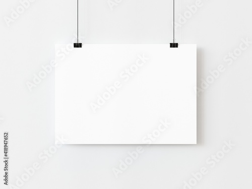Obraz One blank horizontal rectangle poster template hanging on thread with paper clips on white background. 3D illustration - fototapety do salonu
