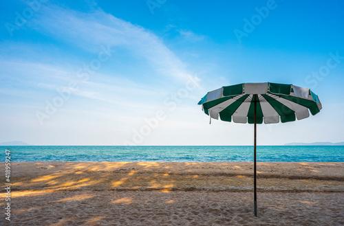 Fotografiet umbrella on the beach in tropical thailand