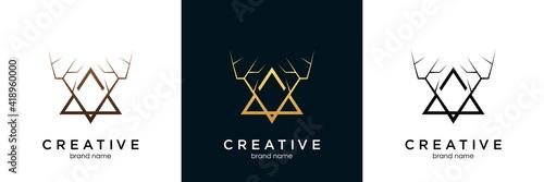 Fotografiet Deer antler logo and icon design vector.