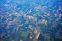 Daytime View From A Flying Plane Over Fields And Land Shares