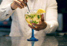 Barman Mixing Mojito Cocktail On A Balloon Cup. Concept For Alcoholic Drinks And Cocktails.