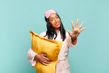 Young Black Woman Smiling And Looking Friendly, Showing Number Five Or Fifth With Hand Forward, Counting Down. Pajamas Concept