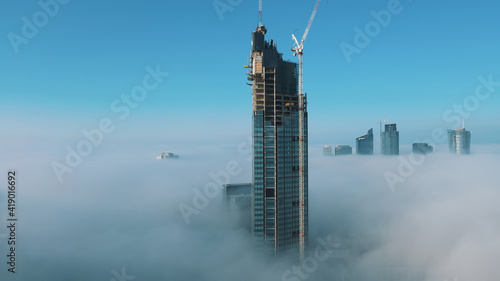 astonishing-aerial-view-of-top-of-the-varso-tower-under-construction-rising-above-clouds-high-quality-photo