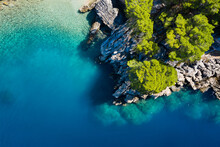 Mediterranean Sea. Aerial View On Water And Rocks During Sunset. Vacation And Adventure. Beach And Blue Water. Top View From Drone At Beach And Blue Sea.
