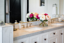 Close Up Of Bathroom Vanity With Flowers.