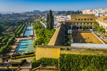 View On The Beautiful Gardens Of The Alcazar De Los Reyes Christanos, A Fortress And The Royal Stables In Cordoba, Andalusia (Spain)
