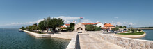 Panoramic Image Of Nin, Historic Medieval Town In The Zadar County Of Croatia. Panoramic Image Of Bridge That Leads To City Center In Lagoon On The Adriatic Sea.