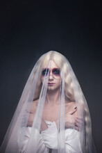 Fabulous Photo For A Halloween Party Portrait Of A Beautiful Woman In The Image Of A Ghostly Bride With Black Makeup On A Black Background