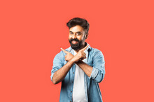 Indian Asian Bearded Man Pointing Or Advertising Blank Space Against Red Background