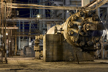 Petrochemical Plant Exterior Huge High Pressure Centrifugal Circulation Compressor For Gas Compression With Current Drive On Concrete Base. Selective Focus Night View Industrial Background.