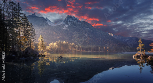 Fototapeta Majestic sunset of the mountains landscape. Wonderful Nature landscape during sunset. Beautiful colored trees over the Hintersee lake, glowing in sunlight. wonderful picturesque scene. color in nature obraz