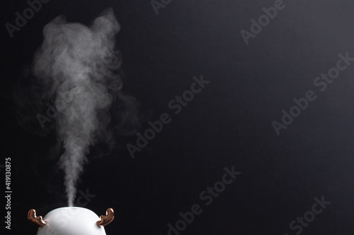 Foto steam generator on a black background
