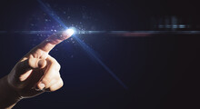 Innovation And Technologies Concept With Man Finger Touching Abstract Digital Screen With Copyspace And Glowing Light