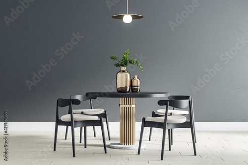 Obraz Black round table with wooden chairs around in the center of modern dining room with black wall and light ceramic tiles floor - fototapety do salonu
