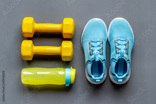Obraz Top view of fitness accessories with dumbbells and sneakers - fototapety do salonu