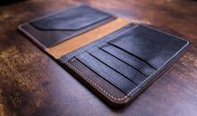 Stylish Handmade Leather Men's Wallet. Genuine Leather Craft. Macro Footage.